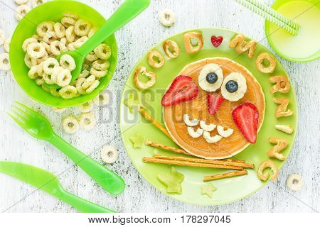 Funny owl pancakes with peanut butter and fruits for kids breakfast