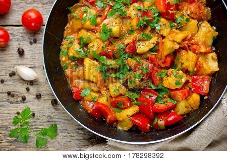 Eggplant stew with sweet pepper tomato and onion. Vegetable stir-fry in frying pan