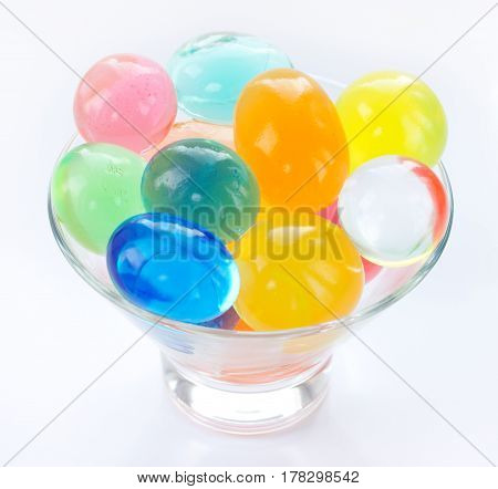 Color balls colored polymer gel hydrogel beads isolated on white background