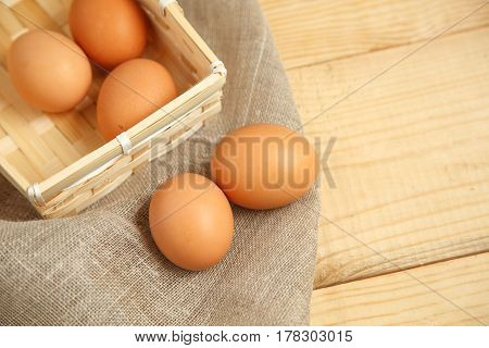 Chicken Egg On Wooden Rustic Background -view From The Top