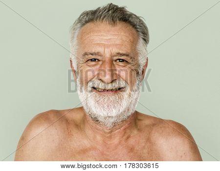 Senior adult man mustache smiling bare chest studio portrait