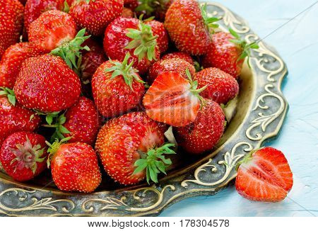 Fresh rip red strawberries on a tray
