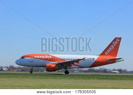 Amsterdam the Netherlands - March 25th 2017: G-EZFS easyJet Airbus A319-100 takeoff from Polderbaan runway.