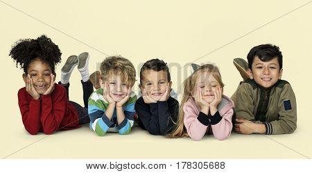 Little Children Laying Down Cheerful