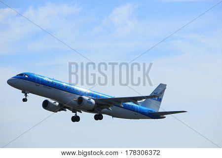 Amsterdam the Netherlands - March 25th 2017: PH-EZY KLM Cityhopper Embraer ERJ-190 takeoff from Polderbaan runway.