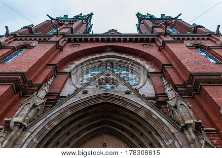 old red brick Johannes Churchin winter in Helsinki, Finland