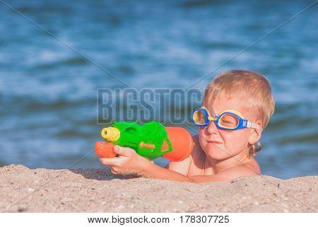 Little Boy Play With Water Gun