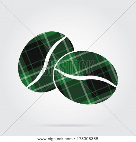 green black isolated tartan icon with white stripes - two coffee beans and shadow in front of a gray background