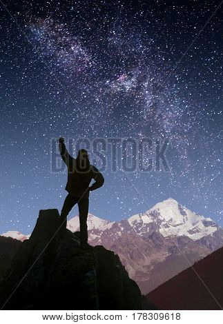 Man Against Milky Way In A Starry Sky