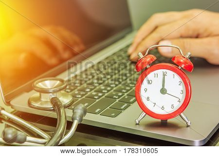 analog clock and stethoscope on the notebook countdown time
