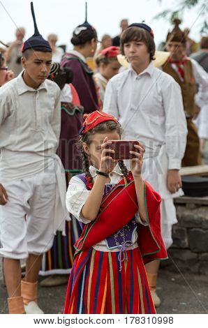 FUNCHAL MADEIRA PORTUGAL - SEPTEMBER 4 2016: girl and boys in traditional costume. Madeira Wine Festival - Historical and Ethnographic parade in Funchal on Madeira. Portugal
