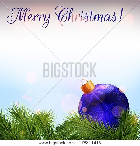 Christmas card. Realistic fir branches and blue christmas bauble with bokeh effect. The words