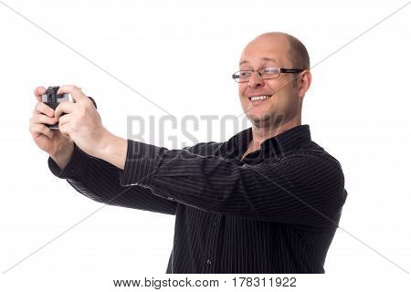 caucasian guy takes a picture of himself using an old camera Isolated on white background