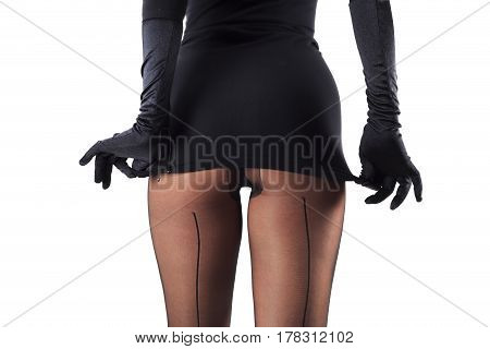 Sexy female legs in beautiful stylish stockings and high heels shoes black gloves and dress isolated on white background horizontal view