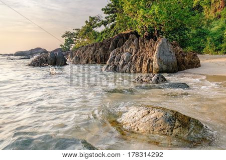 Beautiful seascape. Sea and rock at the sunset. Nature composition. Thai White Sand Beach in sunset time in Koh Chang island, Thailand.