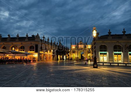 The Arc de Triomphe on Stanislas Square in Nancy. Lorraine. France. Evening scene, the lights are on.