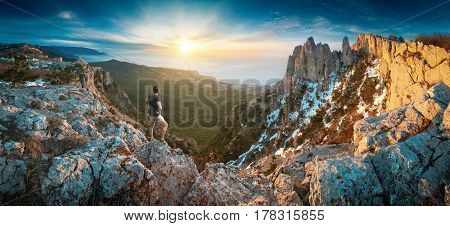 Man Standing On A Cliffs Edge In The Crimea Mountains