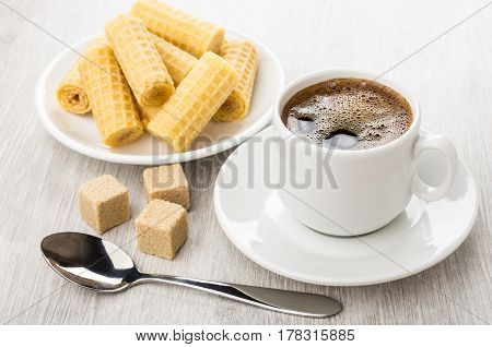 Black Coffee In Cup, Brown Lumpy Sugar, Wafer Rolls