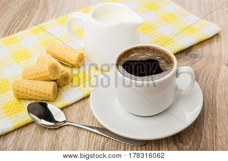 Coffee Cup, Wafer Rolls On Yellow Napkin And Spoon