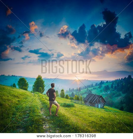 Man Standing On A Road And Enjoy Sunrise