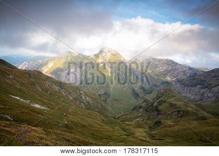 mountain ridge in clouds and sunshine Austria