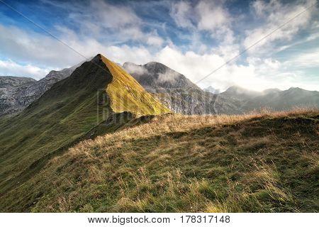 sunlight over mountain ridge and beautiful sky
