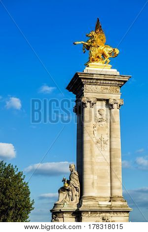 Detail of the Pont Alexandre III, the gilded statue of Fame, Paris, France. This bridge was named after russian Tsar Alexander III.