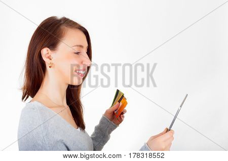 Woman using tablet and credit card for online shopping. Ecommerce