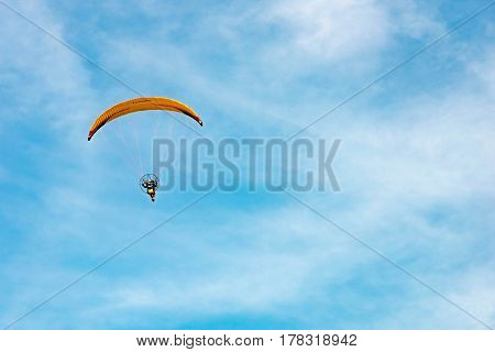 Man Ride Paramotor Flying In The Sky