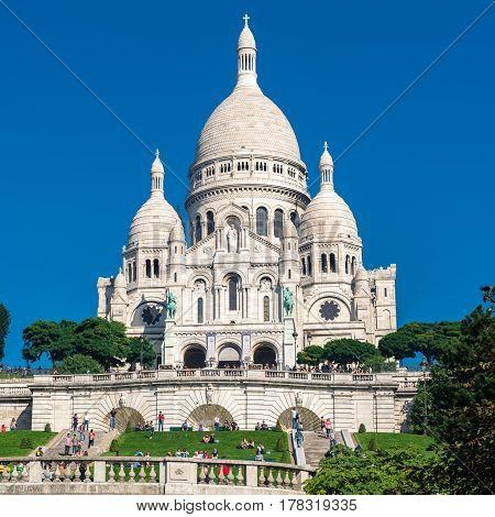 The Basilica of the Sacred Heart of Jesus (Basilique du Sacre-Coeur) on Montmartre hill Paris
