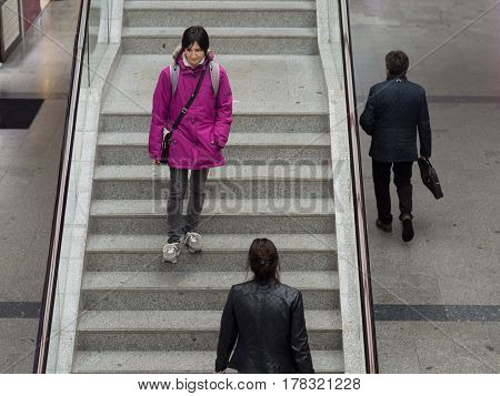 Young woman descending the stairs in a covered market