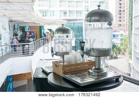 Drinking Water Dispenser With Ice And Plastic Cup On The Table For Meeting, Seminar Or Conference Ro