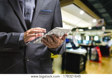 Businessman Use Wireless Digital Tablet Pc In Electric Appliance Shop Or Computer Store