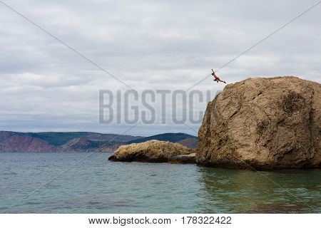 Brave Man Jumps From High Cliff Rock Into the sea on Extreme Vacation