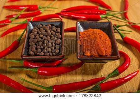 Spices pepper chilli fresh and dry on a wooden Board