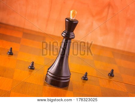 Main and subordinates on a chessboard pawns fight for the king by sacrificing themselves