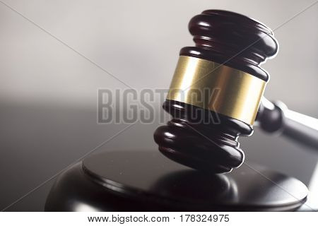 Law and justice theme. Gavel of judge on brown background