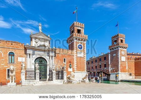 View of Venetian Arsenal under blue sky in Venice, Italy.
