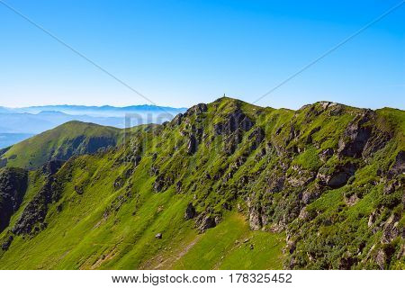 Rocky Mountain Ridge Covered With Green Grass