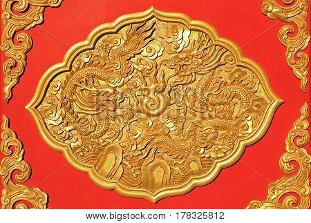 detail of golden ornamental art on chinese wooden door
