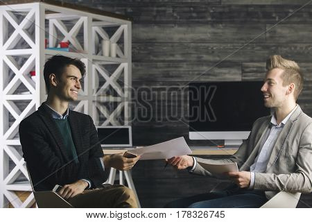 Men Passing Document