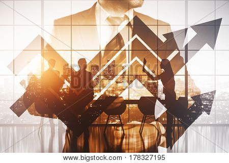 Confident businessman on abstract city and office with upward arrows background. Success concept