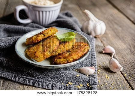 Fried Millet Patties With Oatmeal, Carrot, Egg, Garlic And Onion