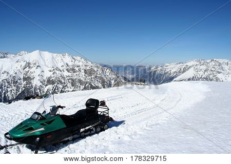 Snowmobile in the mountains of Dombai Caucasus