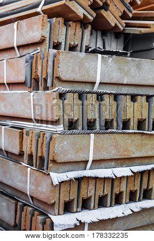 Stack of ceramic construction blocks. Close up.
