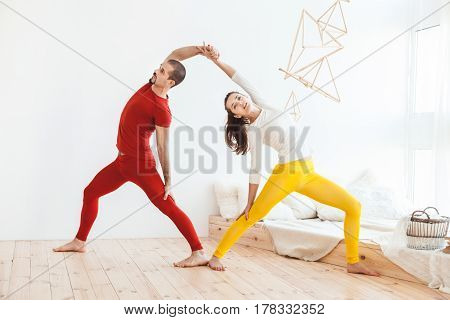 Young couple leads a healthy lifestyle they do morning yoga gymnastics.