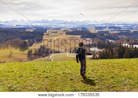 young boy throws to stick anger at the landscape