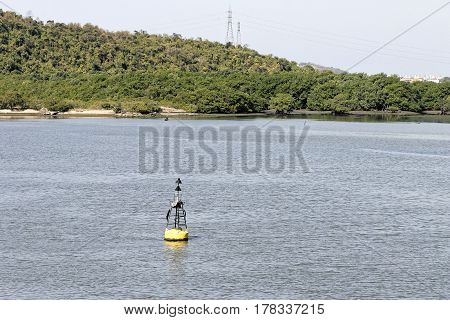 Black Modern Navigation Buoy With Yellow Stripe Floating On A Sea Water. North Cardinal Mark