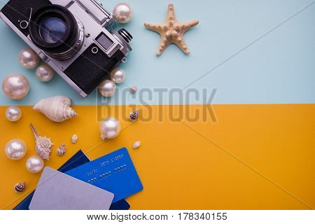 Travel accessories set on colored background, sushi concept