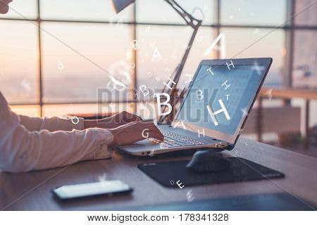 Businesswoman working at home using computer, studying business ideas on a pc screen on-line